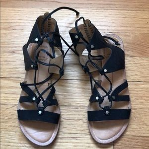 Black lace-up sandals.